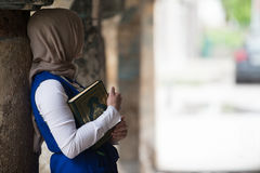 Young Muslim Girl Reading The Koran Royalty Free Stock Images