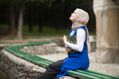 Young Muslim Girl Reading The Koran Royalty Free Stock Photos