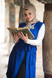 Young Muslim Girl Reading The Koran Royalty Free Stock Photography