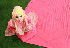 Young muslim girl sitting on grass Royalty Free Stock Photography
