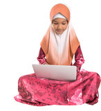 Young Muslim Girl Sitting With Laptop II Royalty Free Stock Photography