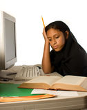 Young Muslim girl studying Stock Image