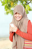 Young muslim girl text a message Royalty Free Stock Photography