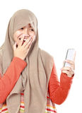 Young muslim girl text message Royalty Free Stock Photography