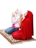 A young muslim girls in traditional clothes prayin Royalty Free Stock Image