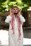 Young Muslim Guy Praying Royalty Free Stock Photo