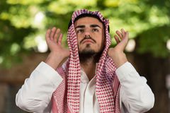 Young Muslim Guy Praying Stock Photo