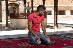 Young Muslim Guy Praying Stock Images