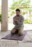 Young Muslim Guy Praying Stock Photography