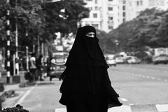 Young muslim lady walking in the city streets unique photo stock photography