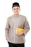 Young muslim man carrying the Quran. Portrait of handsome young muslim carrying the Quran on white background Stock Photos