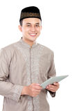 Young muslim man holding a tablet Royalty Free Stock Image