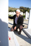 Young muslim man near the his father grave Stock Images