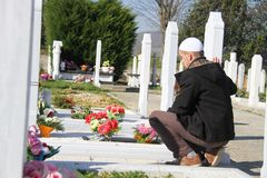 Young muslim man near the his father grave Royalty Free Stock Image