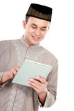 Young muslim man playing on his tablet Royalty Free Stock Photography