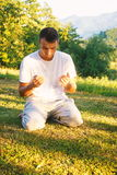 Young Muslim man pray in nature at sunset time Royalty Free Stock Photo