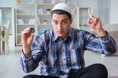 The young muslim man praying at home. Young muslim man praying at home Royalty Free Stock Photography