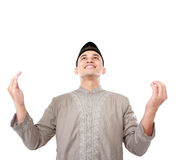 Young muslim man praying. Portrait of young muslim man making traditional prayer to God on white background Royalty Free Stock Photos