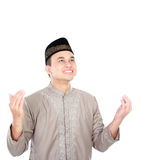 Young muslim man praying. Portrait of young muslim man praying with white background Royalty Free Stock Photos