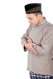 Young muslim man praying Stock Photo