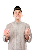 Young muslim man praying to God. Front view portrait of young muslim man looking upward and praying to God Royalty Free Stock Images