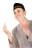 Young muslim man praying to God. Portrait of handsome young muslim man praying to God on white background Royalty Free Stock Image
