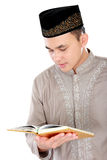 Young muslim man reading a Quran Royalty Free Stock Images
