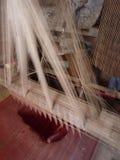 Young muslim man runs a loom Royalty Free Stock Photos