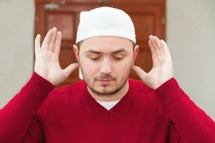Young muslim man showing Islamic prayer Royalty Free Stock Photos