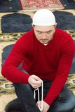 Young muslim man showing Islamic prayer Stock Images