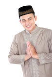 Young muslim man smiling. Portrait of young muslim man smiling and posing on white background Stock Photography