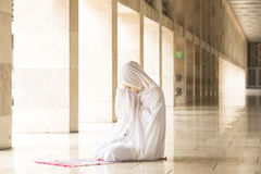 Young muslim praying in mosque Stock Image