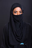 Young muslim woman on black Royalty Free Stock Image