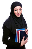 Young muslim woman with book Royalty Free Stock Photo