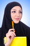 Young muslim woman with book Stock Photo