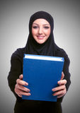 Young muslim woman with book on white Stock Image