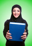 Young muslim woman with book on white Royalty Free Stock Photos