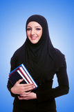 Young muslim woman with book on white Stock Images