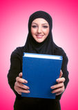 Young muslim woman with book on white Royalty Free Stock Image