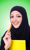 Young muslim woman with book on white Royalty Free Stock Images