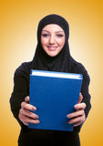 The young muslim woman with book on white Royalty Free Stock Photography