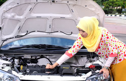Young muslim woman checking engine Stock Photo