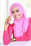 Young muslim woman drinking a glass of milk Royalty Free Stock Photography