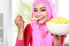 Young muslim woman eating cereal Royalty Free Stock Images