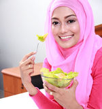 Young muslim woman eating healthy breakfast Stock Photos