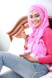 Young muslim woman had a cup of tea for breakfast Stock Photos