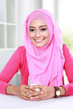 Young muslim woman had a glass of milk for breakfast Stock Photography