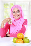 Young muslim woman had a milk and fruits for breakfast Royalty Free Stock Images