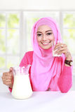 Young muslim woman have a breakfast with milk Stock Images