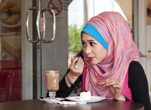 Young muslim woman having lunch at cafe. Beautiful young muslim woman having lunch at cafeteria stock photos